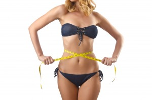 Venus Factor Program Young lady with centimetr in weight loss concept